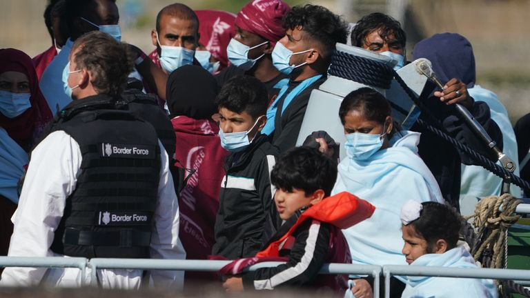 A group of migrants are brought in to Dover, Kent, following a small boat incident in the Channel