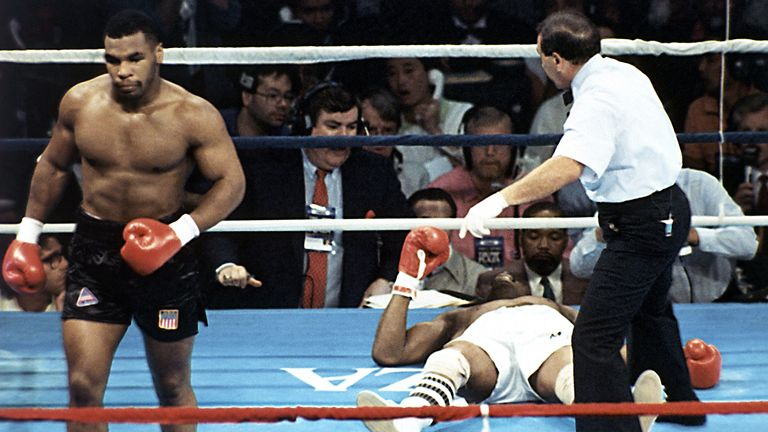 Michael Spinks and Mike Tyson during their 91-second heavyweight fight Trump Plaza in Atlantic City in 1988. Pic: AP