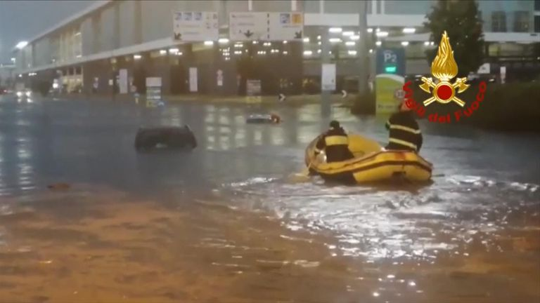 A heavy storm hit northern Italy, forcing closure of Milan's airport and leaving people stranded in their cars in a flooded underpass.