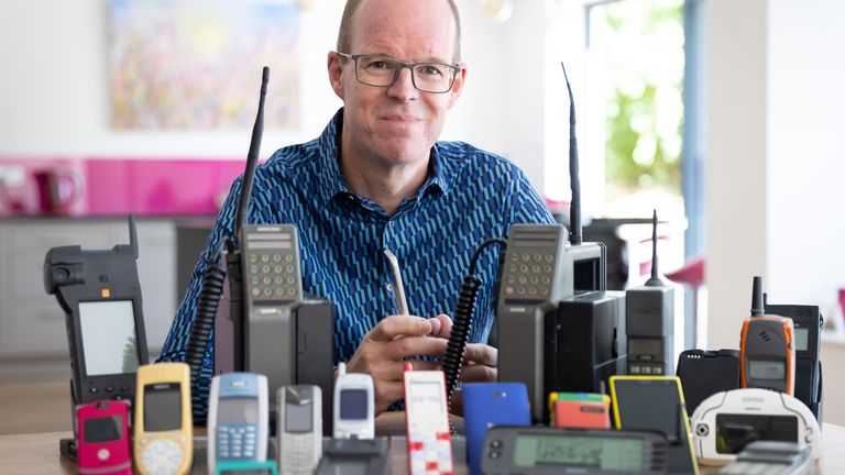 The Mobile Phone Museum founder Ben Wood with some of the over 2,000 unique mobile phones that will be part of the online museum when it launches in November