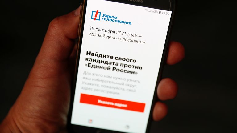 The Russian opposition politician Alexei Navalny's Smart Voting app is seen on a phone, in Moscow