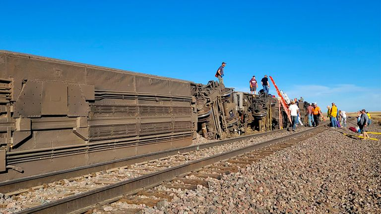 This photo provided by Kimberly Fossen shows an Amtrak train that was derailed on Saturday, Sept. 25, 2021. The train that runs between Seattle and Chicago derailed Saturday afternoon in north-central Montana, local media reported. (Kimberly Fossen via AP)