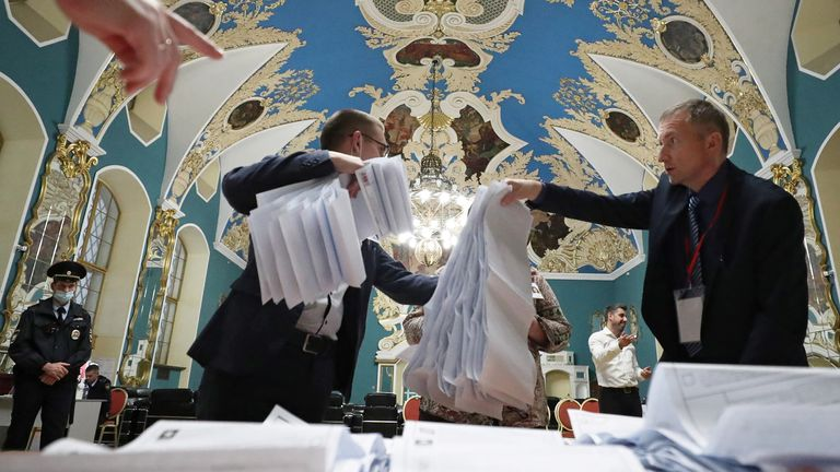 Members of a local election commission counting ballots at Kazansky railway station in Moscow