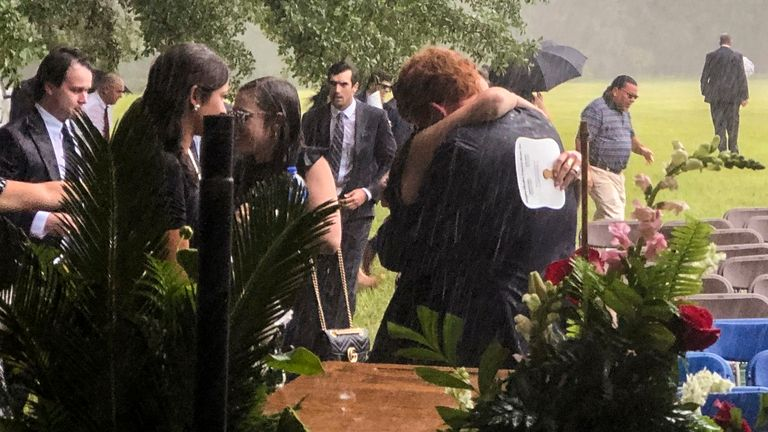 The brother of Paul and Maggie Murdaugh, Buster,  receives a hug at their funeral service on June 11, 2021. Pic: AP
