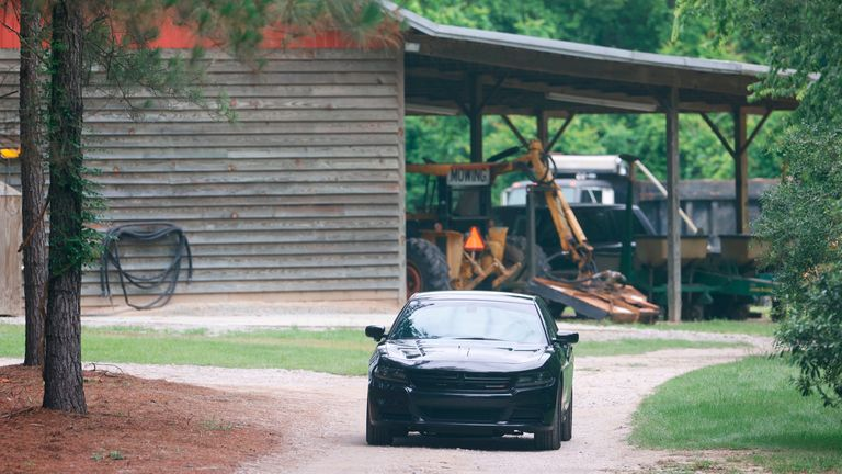 A vehicle sits in the driveway of the home where Paul and Maggie Murdaugh were found shot and killed on the family's land. Pic: Andrew J. Whitaker/The Post And Courier via AP