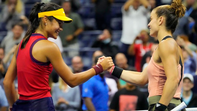 Emma Raducanu of Great Britain (L) shakes hands with Maria Sakkari of Greece (R) after their match on day eleven of the 2021 U.S. Open tennis tournament at USTA Billie Jean King National Tennis Center