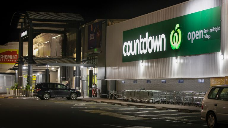 Police stand outside the site of a knife attack at a supermarket in Auckland, New Zealand PIC:AP