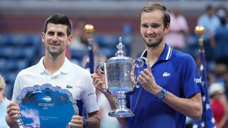 (L-R) Novak Djokovic of Serbia and Daniil Medvedev of Russia celebrate with the finalist and championship trophies, respectively, after their match in the men's singles final on day fourteen of the 2021 U.S. Open tennis tournament at USTA Billie Jean King National Tennis Center. Mandatory Credit: Danielle Parhizkaran-USA TODAY Sports