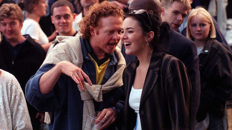 Mick Hucknall and Martine McCutcheon at one of Oasis's Knebworth gigs