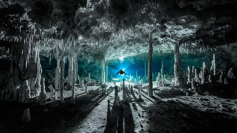 Speleothems cast long shadows at cenote Dos Pisos, Quintana Roo, Mexico. Pic: Martin Broen/Ocean Photography Awards