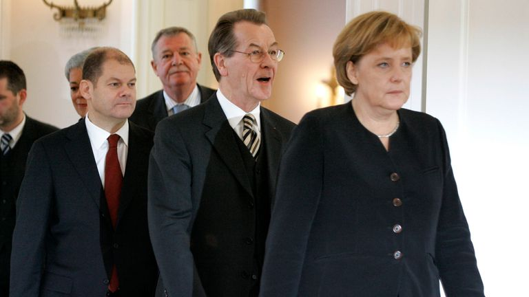 Mr Scholz served as minister for labour in Angela Merkel's first cabinet after his appointment in 2007. Pic: AP