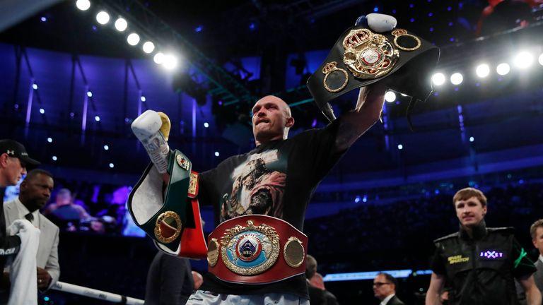 Oleksandr Usyk celebrates winning his fight against Anthony Joshua
