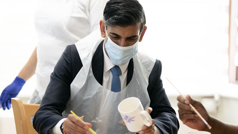 Chancellor of the Exchequer Rishi Sunak paints a mug during a visit to Westport Care Home in Stepney Green, east London, ahead of unveiling his long-awaited plan to fix the broken social care system. Picture date: Tuesday September 7, 2021.  Paul Edwards/The Sun/PA Wire/PA Images