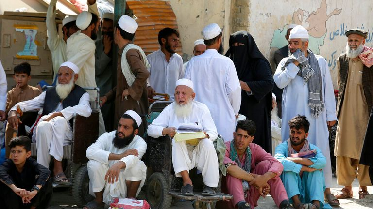 Afghans wait at the Pakistan border. Pic: AP