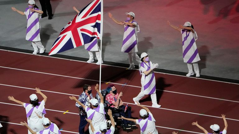 Flag bearers from Britain enter the stadium during the closing ceremony for the 2020 Paralympics at the National Stadium in Tokyo, Sunday, Sept. 5, 2021. (AP Photo/Eugene Hoshiko)