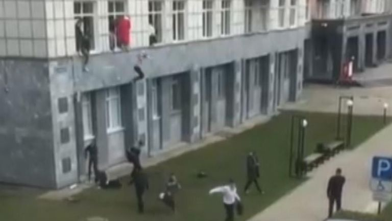 Students jump out of the university building in Perm, Russia, after gunman opens fire on campus