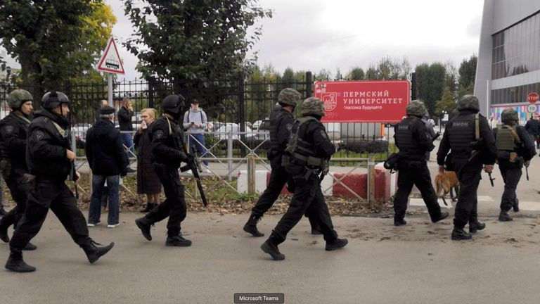 Law enforcement officers work near the scene after a gunman opened fire at the Perm State University in Perm, Russia September 20, 2021, in this still image taken from video. REUTERS/Anna Vikhareva NO RESALES. NO ARCHIVES