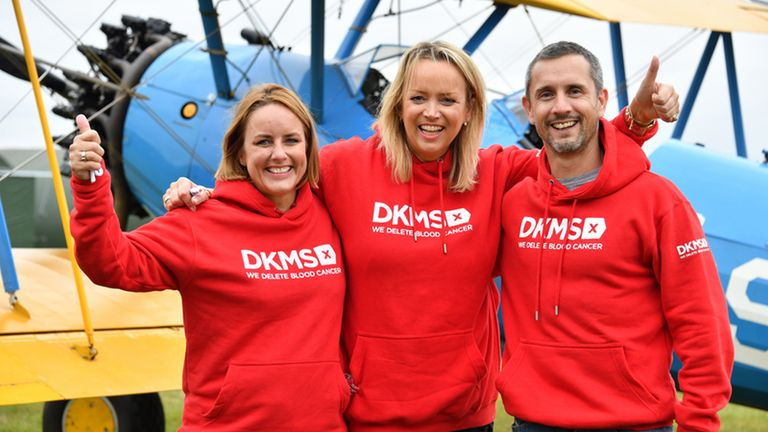 From left: Sally Hurman, Lisa Jackson and Peter McCleave after completing a wing walk at Damyns Hall Aerodrome in Essex,