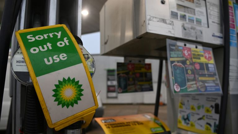 Out of use signs are placed over pumps at a BP petrol station in London