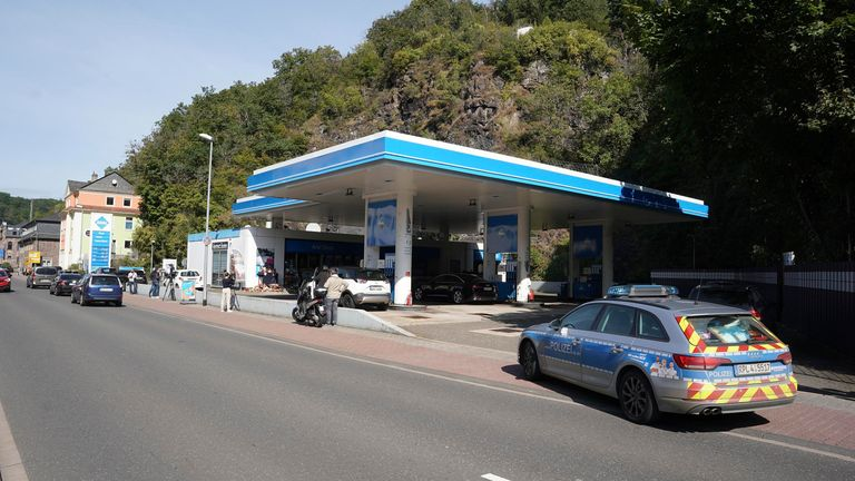 A police car is parked at a gas station in the city center. An employee of the gas station had been shot by a man armed with a pistol on Saturday evening. The employee had pointed out to the suspect that masks were mandatory, as he wanted to buy beer without a mask. Later, the man returned and shot the victim.  PIC:AP
