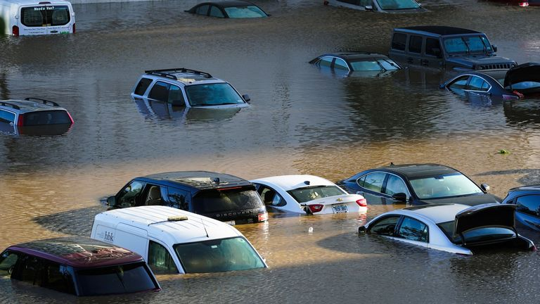 Vehicles under water during flooding in Philadelphia. Pic: AP
