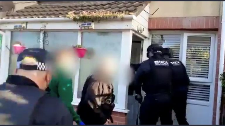 Officers were seen entering the property as they carried out their raid
