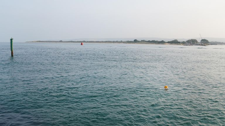 A yellow buoy marks the area in the Sandbanks area of Poole Harbour near where a plane crashed into the sea