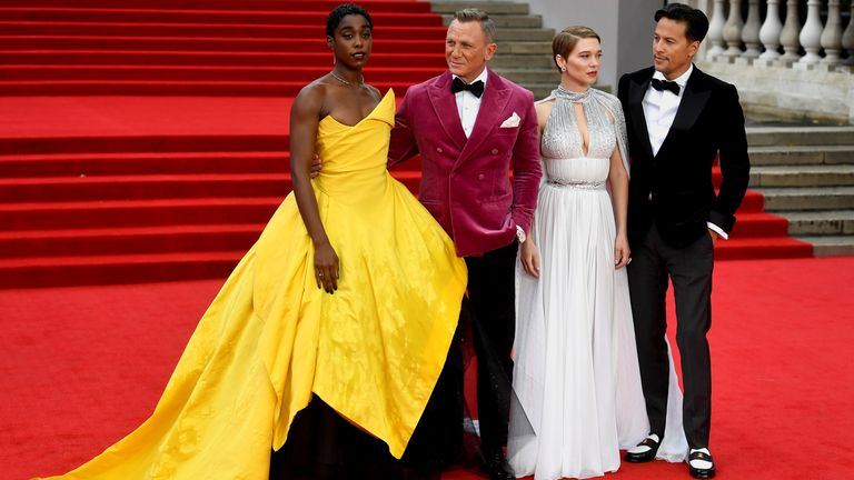 """Cast members Lashana Lynch, Daniel Craig, Lea Seydoux and director Cary Fukunaga pose during the world premiere of the new James Bond film """"No Time To Die"""" at the Royal Albert Hall in London, Britain, September 28, 2021. REUTERS/Toby Melville"""