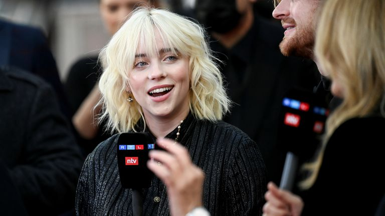 """Singer Billie Eilish speaks to the media during the world premiere of the new James Bond film """"No Time To Die"""" at the Royal Albert Hall in London, Britain, September 28, 2021. REUTERS/Toby Melville"""