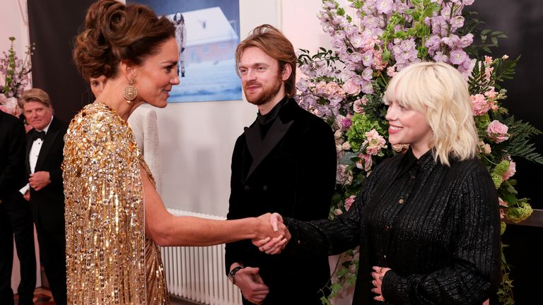 The Duchess of Cambridge talks with performers Finneas O'Connell and Billie Eilish upon her arrival for the World Premiere of No Time To Die, at the Royal Albert Hall in London. Picture date: Tuesday September 28, 2021.