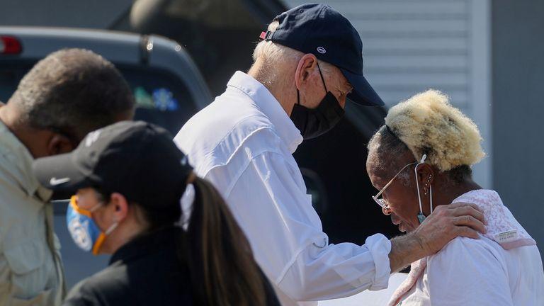 U.S. President Joe Biden talks to residents as he tours a neighborhood hit by Hurricane Ida in LaPlace, Louisiana