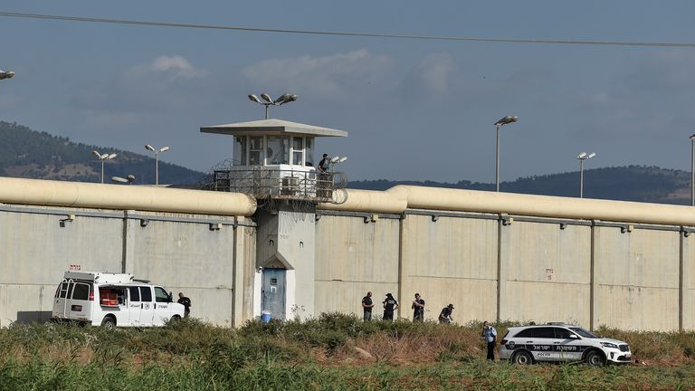 Israeli security personnel stand together during searches outside Gilboa prison after six Palestinian militants broke out of it in north Israel