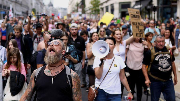 Anti-vaccine protesters march in London.