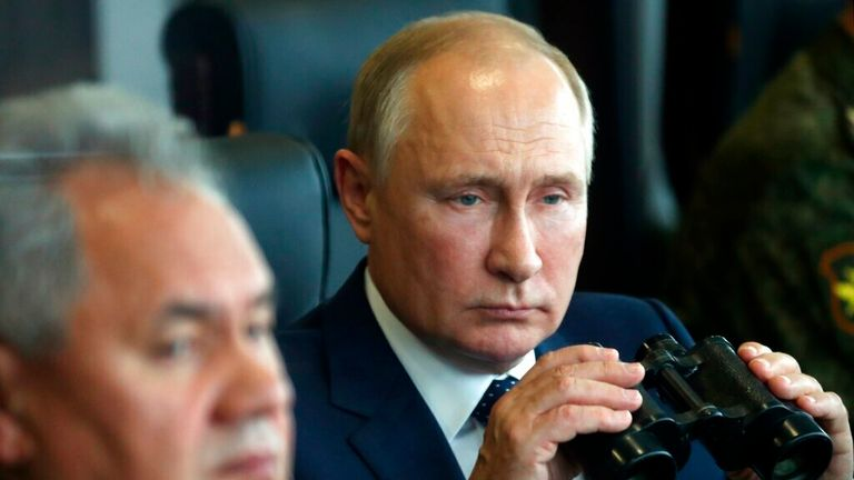 Russian President Vladimir Putin, right, holds a binoculars as Russian Defense Minister Sergei Shoigu sits near watching the joint strategic exercise of the armed forces of the Russian Federation and the Republic of Belarus Zapad-2021 at the Mulino training ground in the Nizhny Novgorod region, Russia, Monday, Sept. 13, 2021.