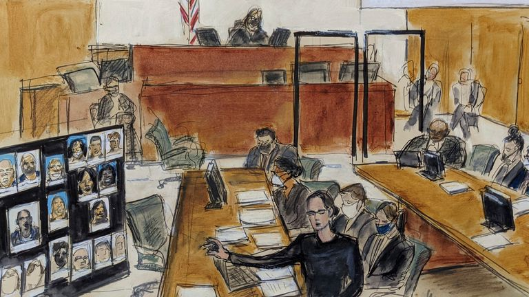 In this illustration drawn from a video feed, Assistant US Attorney Elizabeth Geddes, bottom, presents her closing statement to the jury (not seen in video feed) while pointing to a large panel of photos of R. Kelly's inner circle and employees, Wednesday, Sept. 22, 2021, in New York. R. Kelly is seen seated at the defense table in inset on upper left. He is also seated far right at the bottom on the image. (AP Photo/Elizabeth Williams)