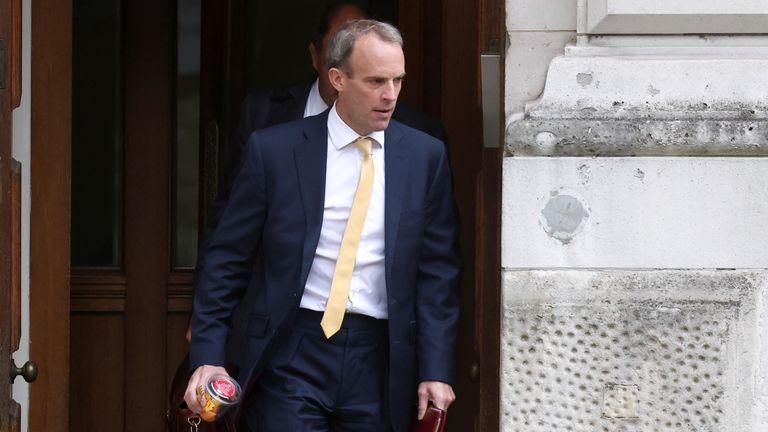 Britain's Foreign Secretary Raab walks outside FCDO in London