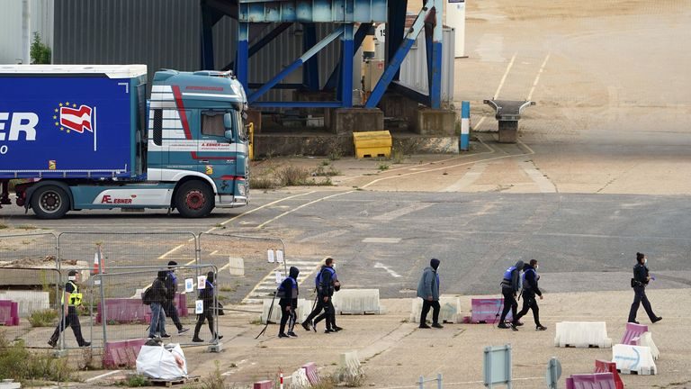 A group of people thought to be migrants are brought in to Ramsgate, Kent, by Border Force officers on 26 September