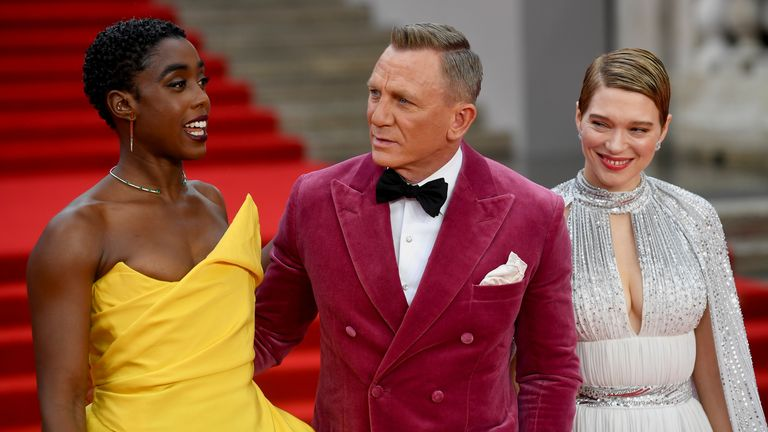 """Cast members Lashana Lynch, Daniel Craig and Lea Seydoux pose during the world premiere of the new James Bond film """"No Time To Die"""" at the Royal Albert Hall in London, Britain, September 28, 2021. REUTERS/Toby Melville"""