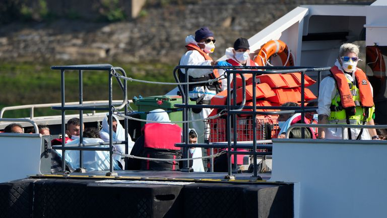 People thought to be migrants arrive onboard a British Border Force patrol boat after being picked up from a dingy in the English Channel in Dover PIC:AP