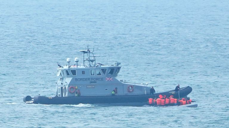 A Border Force vessel intercepts a group of people thought to be migrants in a small boat off the coast of Dover in Kent. Picture date: Friday September 17, 2021.