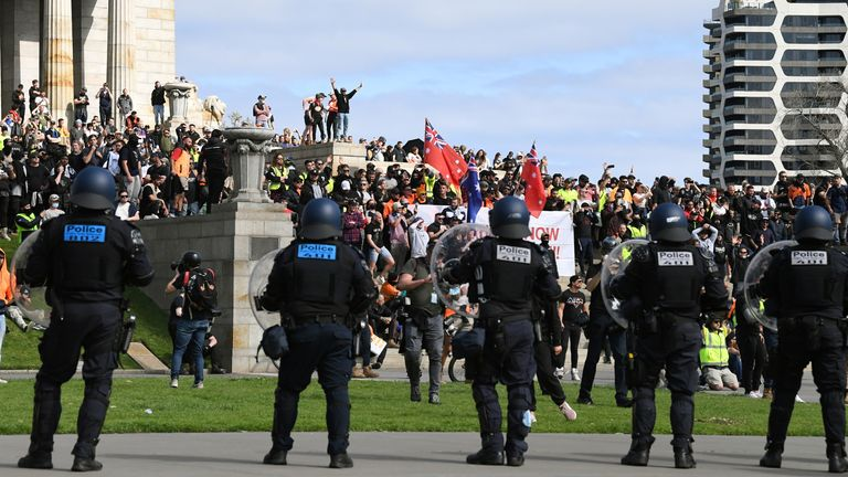 Protesters rally against construction industry COVID-19 mandates in Melbourne as riot police look on