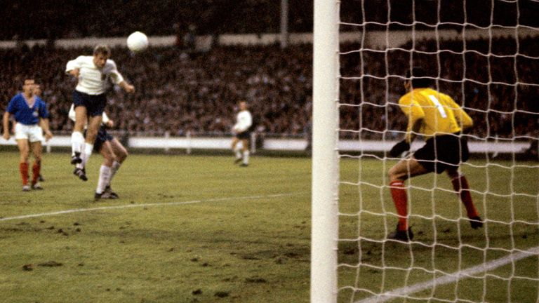 England's Roger Hunt (c) heads the second goal past France goalkeeper Marcel Aubour (r) Picture by: PA Photos/PA Archive/PA Images Date taken: 20-Jul-1966