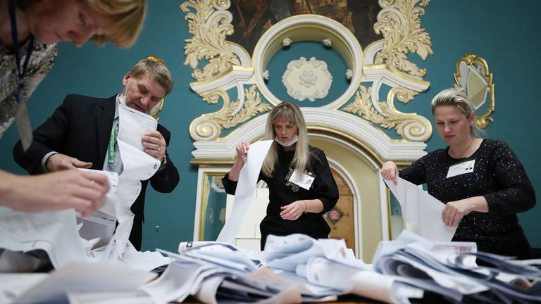 Members of a local election commission count ballots at a polling station inside Kazansky railway terminal in Moscow
