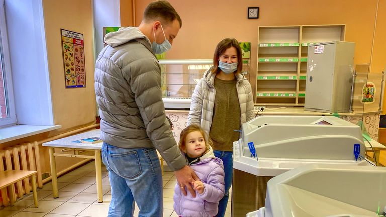 Dmitry brought his family in to vote at a polling station in central Moscow