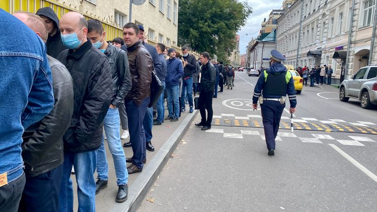 Long queue of people waiting to vote outside polling station at the first day of elections in Russia