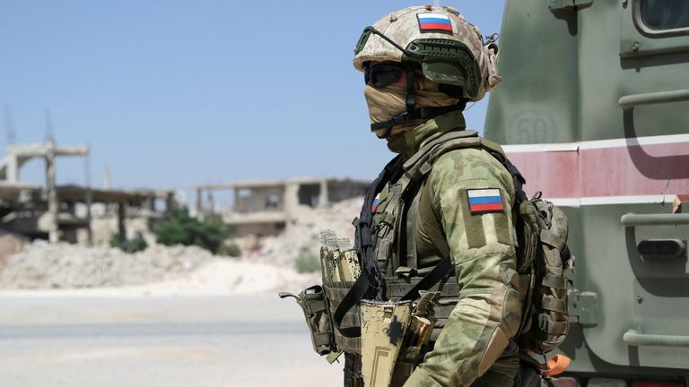 Russia forces, such as this military police officer, remain in parts of Syria