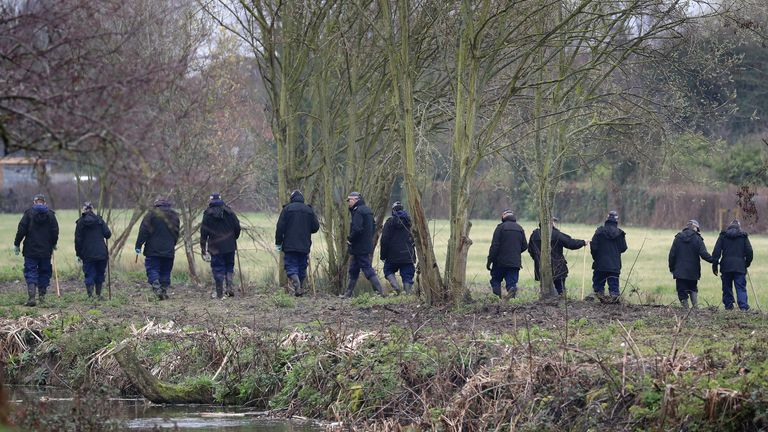 Police officers conduct searches after Sarah Everard's body was found in woodland in Ashford, Kent