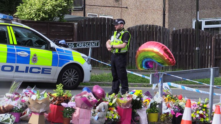 Flowers near to the scene in Chandos Crescent, Killamarsh, near Sheffield, where the bodies of John Paul Bennett, 13, Lacey Bennett, 11, their mother Terri Harris, 35, and Lacey's friend Connie Gent, 11, were discovered at a property on Sunday morning.