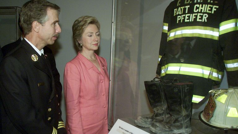 Chief Pfiefer, and then New York Senator Hilary Clinton, as his equipment is displayed at the Museum of American History on 10 September 2002