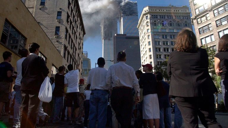 People watch smoke billow from the Twin Towers. Pic: AP